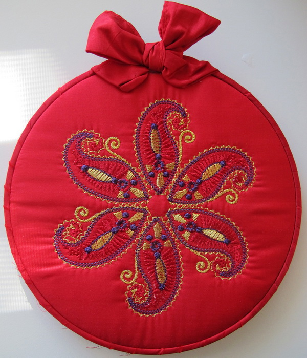 Blue Crush Machine Embroidery Designs by Stitchingart. Artistic decorative red foot stool.