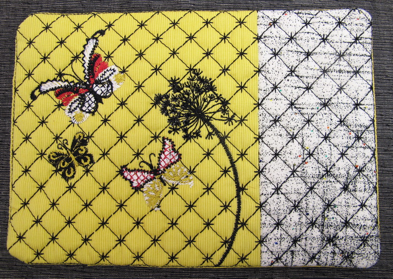 Earth Dance Machine Embroidery Designs. Butterfly, love hears, floral and flower mug rug. Pretty machine embroidery design. Great use of decorative stitches.