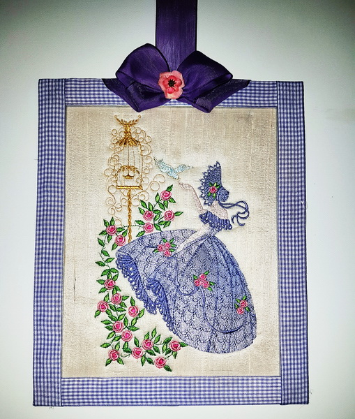 Crinoline Lady Machine Embroidery Designs by Stitchingart. Embroidered picture of lady with old fashioned dress and bonnet holding birds and roses
