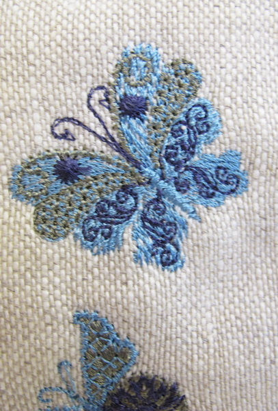 Earth Dance Machine Embroidery Designs. Butterfly, love hears, floral and flower bag. Pretty machine embroidery design.