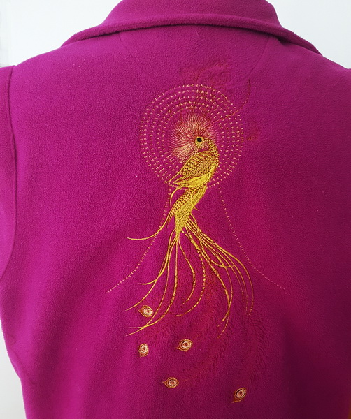 Mayil Machine Embroidery Designs by Stitchingart. Peacock design on the back of a sweater jumper.