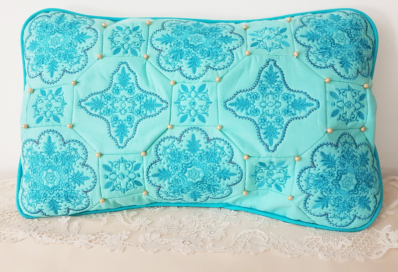 Panache Machine Embroidery Designs by Stitchingart. Aqua floral pretty decorative cushion.