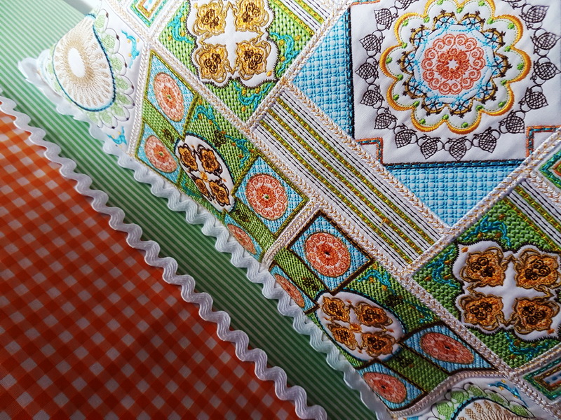 Sorbet Shades Machine Embroidery Designs. Beautiful pattern embroidered coloured pillow. Close up of cushion.