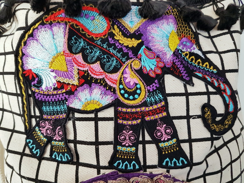 Wild and Free Machine Embroidery Designs by Stitchingart. Embroidered artistic elephant bag.