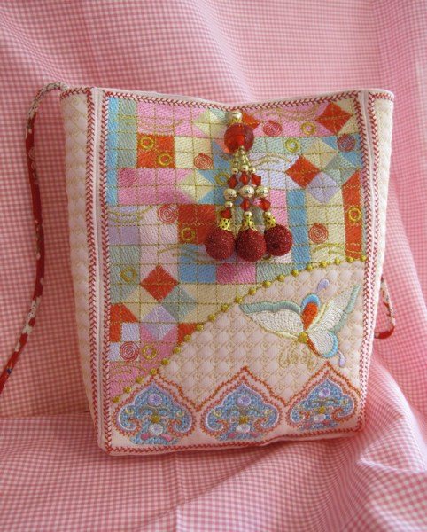Harmony Machine Embroidery Designs by Stitchingart. Bag with artistic patterns and butterfly.