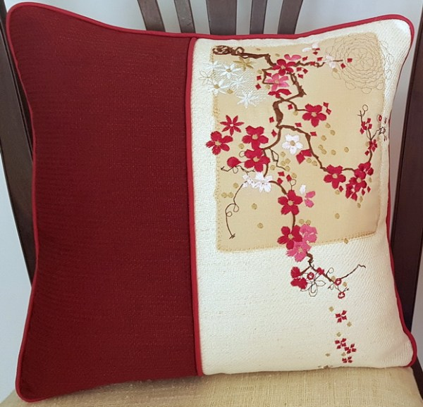 In the Air Machine Embroidery Designs by Stitchingart. Floral embroidered cushion.