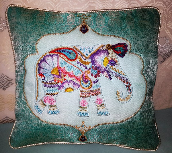 Wild and Free Machine Embroidery Designs. Elephant artistic embroidery deisgns on a pillow. Indian Elephant